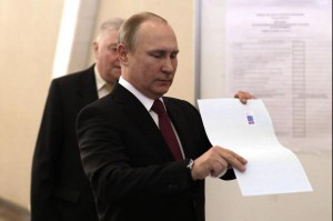 Russian President holds his ballot at a polling station during the presidential election in Moscow on Sunday. Photo by Yuri Gripas/UPI. | License Photo