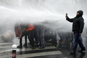 Riot police uses water cannon against protesters during clashes as part of a demonstration during a nation-wide strike day affecting public services, in Paris, France, March 22, 2018. A national strike day was called by public sector workers and labor unions to defend labor rights and pensions. EPA-EFE/Yoan Valat