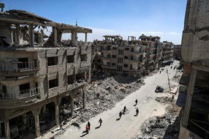 A general view of a destroyed street in rebels-held Douma, Syria, March 9, 2018. U.S. President Donald Trump has decided to freeze more than $200 million in aid to Syrian recovery efforts. Photo by EPA-EFE/Mohammed Badra