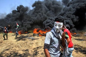 A Palestinian youth wears a mask at a protest in Khan Younis at the Israel-Gaza border Friday. Israeli troops killed several Palestinians and injured dozens more, medical sources said. Photo by Ismael Mohamad/UPI | License Photo