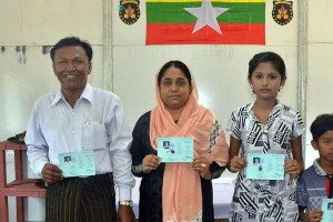 Family members pose with identification cards -- the first Muslim minority Rohingya to be repatriated to Myanmar from Bangladesh, the government said. Photo courtesy Myanmar Ministry of Information