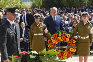 From left to right, Chairman of Yad Vashem, Avner Shalev; Israeli Prime Minister Benjamin Netanyahu; and Knesset Speaker Yuli Edelstein attend a ceremony marking the annual Holocaust Remembrance Day at Yad Vashem Holocaust Memorial in Jerusalem on Thursday. Photo by Debbie Hill/UPI | License Photo