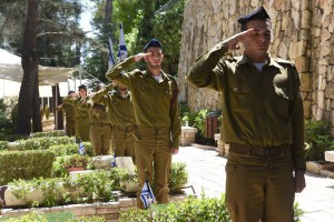 Israeli soldiers salute after placing small national flags on the graves of fallen soldiers Monday for Israeli Remembrance Day in the Mt. Herzl Military Cemetery in Jerusalem, Israel. Photo by Debbie Hill/UPI | License Photo