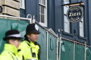 Police stand near the cordoned off Zizzi restaurant after traces of a nerve agent used against former Russian spy Sergei Skripal and his daughter were found. File photo by Neil Hall/EPA-EFE