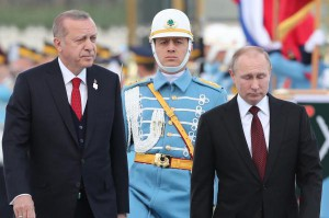 Turkish President Recep Tayyip Erdogan (L) and Russian President Vladimir Putin (R) review honor guards during a welcoming ceremony at the Presidential Palace in Ankara. Photo by Tolga Bozoglu/ EPA-EFE