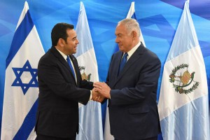 Guatemalan President Jimmy Morales (L) shake hands with Israeli Prime Minister Benjamin Netanyahu in his office in Jerusalem on Wednesday. Photo by Debbie Hill/UPI | License Photo