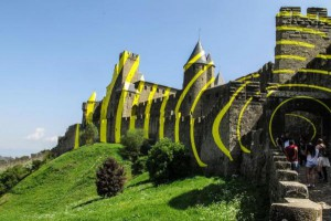 A temporary art installation in which the ancient medieval fortress in Cacassonne, France, is covered in yellow stripes and circles is drawing praise and outrage. Photo by Armando Babini/EPA-EFE