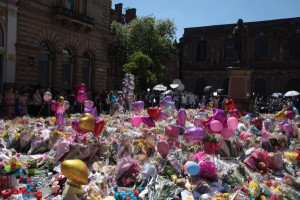 A makeshift memorial honors 22 people killed in the Manchester bombing on May 26, 2017. Tuesday, Britain will mark the first anniversary of the suicide attack with a moment of silence. File photo by Mushtaq Mohammed/UPI | License Photo