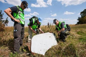 Dutch investigators collect debris from Malaysia Airlines Flight 17, a Boeing 777 that crashed on July 16, 2014 after it was deliberately downed by a missile. Officials said Thursday the missile system was owned by Russia. Photo courtesy Dutch Ministry of Defense