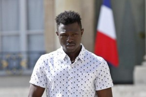 Mamoudou Gassama, a 22 year old from Mali, was given a medal for his act of bravery and promised French citizenship by President Emmanuel Macron. Photo by Thibault Camus/EPA-EFE