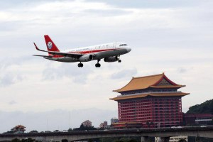 A Sichuan Airlines het flies lands at Taipei Songshan Airport in Taipei, Taiwan, in January. A Sichuan pilot was nearly expelled from a flight Monday after the cockpit window broke in flight. File Photo by David Chang/EPA-EFE