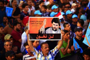 A supporter holds a poster of Iraqi Shia cleric Muqtada al-Sadr at a campaign rally in Tahrir Square in Baghdad, Iraq. Photo by Ali Abbas/ EPA-EFE