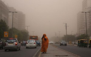 A woman walks with her face covered to avoid a dust storm in New Delhi on May 2. Gender discrimination in India kills 240,000 girls under the age of five each year, mostly due to neglect, a study has found. Photo by Rajat Gupta/EPA-EFE