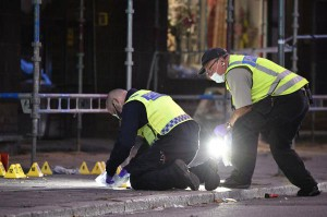 Police search the scene of a shooting late Monday in Malmo, Sweden, that killed three men and injured three other people. Officials said it doesn't appear terror-related. Photo by Johan Nilsson/EPA-EFE