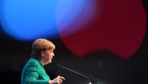 epa06391829 German Federal Chancellor Angela Merkel delivers her speech at the annual convention of the Christian Social Union party (CSU) in Nuremberg, Germany, 15 December 2017. In their two-day meeting, delegates will vote a new head of party and the top candidate for federal state elections in Bavaria in autumn 2018. EPA-EFE/LUKAS BARTH