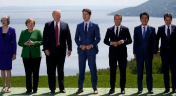 The 'family photo' at the G7 summit offers a glimpse of the tension between world leaders amid a bitter trade battle with the US