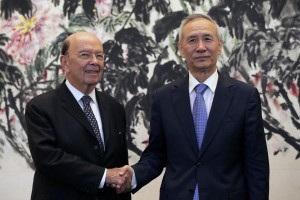 U.S. Commerce Secretary Wilbur Ross (L) has said the United States has struck a deal with ZTE, the Chinese telecom company, so U.S. sanctions against the firm could be terminated. The move came a day before China released trade data on Friday. File Pool Photo by Andy Wong/EPA-EFE