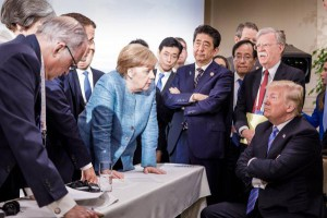 German Chancellor Angela Merkel speaks to President Donald Trump at the G7 Summit in La Malbaie, Quebec, Canada, Saturday. Photo courtesy of German Federal Government/Twitter/UPI | License Photo