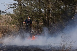 An Israeli firefighter attempts to extinguish a fire near Kibbutz Kfar Azza, along the border of the Gaza Strip, that was ignited by kites sent by Palestinian protesters in Gaza on Tuesday. Photo by Debbie Hill/UPI | License Photo