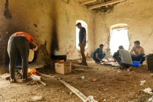 Displaced migrants bake bread and cook in an abandoned building on the outskirts of Horgos, Serbia, near the Hungarian border on April 15. File photo by Edvard Moinar/EPA-EFE