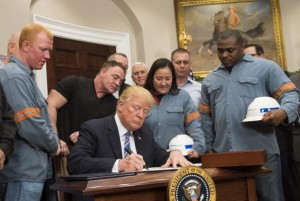 President Donald Trump signs a proclamation to impose tariffs on steel and aluminum imports at the White House on March 8. This week, the World Bank warned that such tariffs could lead to another financial crisis. File Photo by Kevin Dietsch/UPI | License Photo