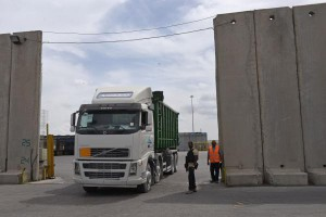 A truck transports cargo from Israel to Gaza at the Kerem Shalom crossing in the southern Gaza Strip. On Monday, Israeli officials ordered the crossing closed. File Photo by Debbie Hill/UPI | License Photo