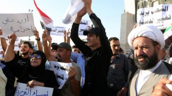 Iraqi police shoot tear gas, water cannons at protesters