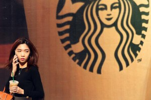 A Chinese woman leaves a new Starbucks in downtown Beijing. The coffee retailer faces tough competition in the world's second largest economy. File Photo by Stephen Shaver/UPI | License Photo