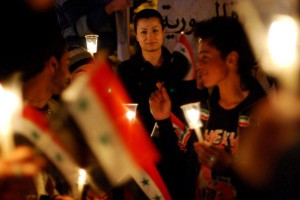 Anti-government protesters hold the Syrian flags and candles at Shuhada or (Martyrs) Square in Swaeda in Daraa, Syria, on March 28, 2011. Syrian forces captured the city away from rebels Thursday. File Photo by Ali Bitar/UPI | License Photo