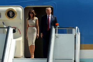 U.S. President Donald Trump and first lady Melania Trump arrive at London Stansted Airport in Essex Thursday for their first official visit to Britain. The Trumps arrived from Belgium, where the president attended the second day of a NATO conference. Photo by Sean Dempsey/EPA-EFE