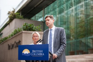 Minister of Mental Health and Addictions Judy Darcy (L) and British Columbia Attorney General David Eby announce a lawsuit against more than 40 pharmaceutical companies over the state's opioid crisis Wednesday outside the Supreme Court in Vancouver, Canada. Photo courtesy of British Columbia