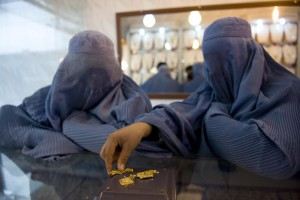 Two women wearing burqas purchase gold in a jewelry shop in Herat, Afghanistan. Thursday, British Conservative Party leaders called for an investigation into burqa-related comments from former Foreign Secretary Boris Johnson. File Photo by Hossein Fatemi/UPI | License Photo