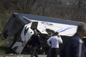 Bulgarian police officers stand in front of the wreckage of a Bulgarian bus that crashed in April, killing 10 people. On Saturday, a Bulgarian tourist bus crashed near the Iskar Gorge in Bulgaria, killing 16 people and injuring several others. Photo by Vassil Donev/EPA-EFE