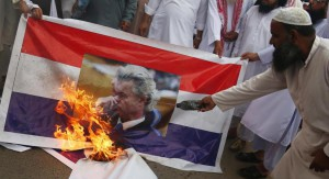 People burn a mock up of Holland's flag with a photo of Dutch politician Geert Wilders in Karachi, Pakistan, on Thursday. Photo by Shahzaib Akber/EPA-EFE