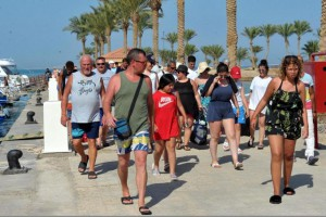 Tourists walk in the resort city of Hurghada, Egypt, where a British couple mysteriously died this week. Three hundred hotel guests were relocated. File Photo by EPA-EFE