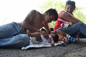 Two Central American migrants and their young daughter rest in the town of Tapachula, on the western border between Mexico and Guatemala, in April 2017 before approaching Mexico's immigration authorities for asylum. File Photo by Eduardo Torres/EPA