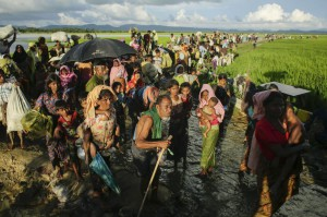 Rohingya migrants enter Bangladesh from Budichong, Myanmar, on October 9, 2017. The Myanmar government rejected a United Nations report on Wednesday, citing atrocities against the Rohingya population and a call for six top generals to be tried on genocide charges. File Photo by Abir Abdullah/EPA-EFE