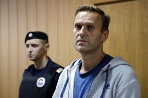 Russian opposition leader Alexei Navalny (R) appears during a judicial sitting in Tverskoy court in Moscow, Russia, on Monday. Photo by Yuri Kochetkov/EPA-EFE