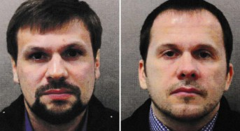 2 Russians charged with poisoning ex-spy, daughter in Britain