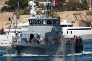 A Maltese Armed Forces of Malta patrol boat P52 carried 58 migrants and a dog from the Aquarius migrant ship to disembark in the country Sunday. Photo by Domenic Aquilina/EPA