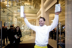 A customer holds a new iPhone Friday as the first customer to receive the new XS model at the Apple Store in Amsterdam, the Netherlands. Photo by Koen Van Weel/EPA-EFE