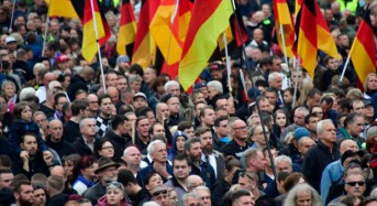Thousands protest for and against migrants in Germany's Chemnitz