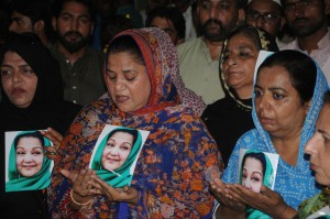 Pakistani women hold photographs of former first lady Begum Kulsoom Nawaz in Multan, Pakistan, on June 17. Supporters expressed concern for the 68-year-old public figure as she underwent cancer treatment in London. Begum Kulsoom died Tuesday. File Photo by Faisal Kareem/EPA-EFE