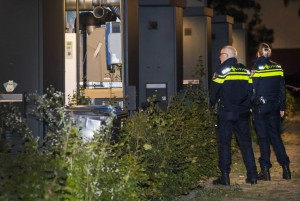 Dutch police officers search the residence of an alleged jihadist in Arnhem, the Netherlands, on Thursday. Photo by Piroschka van de Wouw/EPA-EFE