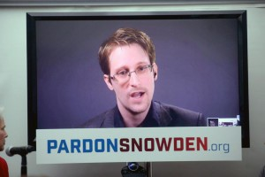 Whistle-blower Edward Snowden speaks at a conference via a monitor at the launch of a campaign in 2016 calling on then-President Barack Obama for a pardon. Snowden revealed the existence of a secret NSA phone surveillance program in 2013, and later a similar effort by the British government. File Photo by Dennis Van Tine/UPI | License Photo