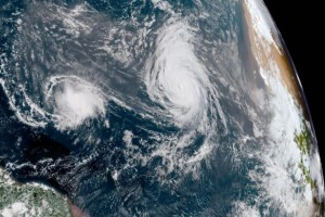 Hurricane Helene (right) trails Tropical Storm Isaac in the eastern Atlantic Ocean Tuesday. Helene is forecast to turn north away from the United States and is not expected to arrive on land. Image courtesy NOAA