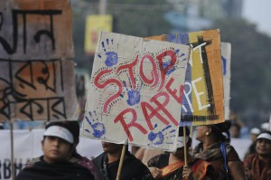 "People marched on the streets with ""stop rape"" signs during a rally to remember the gang raped victim from New Delhi on December 16, 2014. Photo by arindambanerjee/Shutterstock"