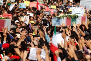 Iranians carry coffins of victims of a terror attack last weekend in Ahvaz in southern Iran. Authorities said they have arrested 22 people tied to the attack. Photo by EPA-EFE