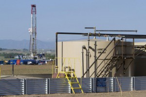 A drilling rig operates on farmland near a storage tank at the Niobrara oil shale formation in Weld County, Colorado. The rig count in the United States rose by 101 in 12 months. Photo by Gary C. Caskey/UPI   License Photo