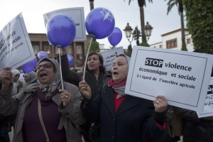 Demonstrators hold signs that read, 'Stop Violence' to protest against violence against women in Rabat, Morocco, on November 25, 2016 -- which has been designated by the U.N. General Assembly as International Day for the Elimination of Violence Against Women. File Photo by Abdelhak Senna/EPA